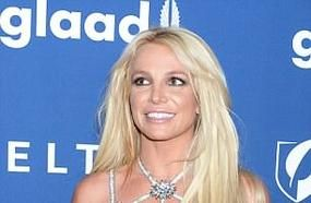 Britney Spears Flaunts Her Toned Figure In A Skimpy Silver Dress With Cut-Out Detailing As She Attends Star-Studded