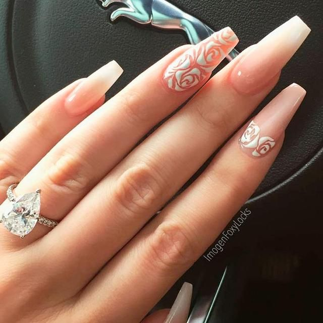 Roses and crystals will turn your coffin nails into a masterpiece. These long  nail designs look brilliant and extremely glamorous. - 11 Best Long Nail Designs For Glamorous Girls - PolyTrendy