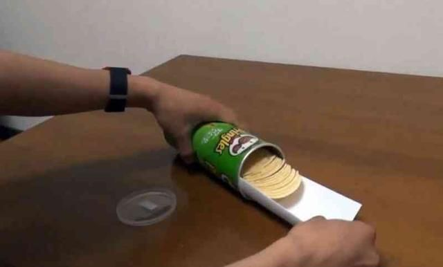 slide a sheet of paper into the tube and pull the chips out