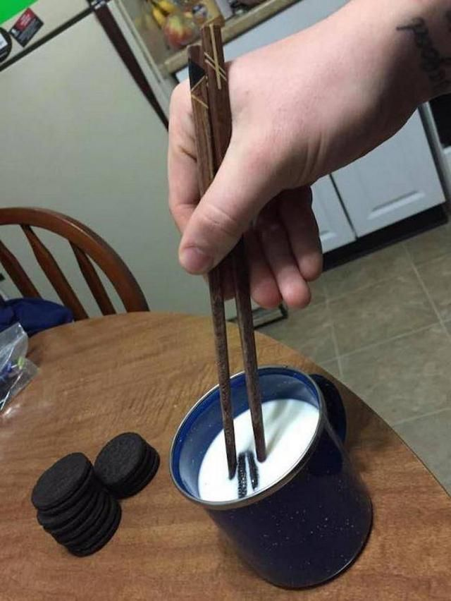 eating Oreos and milk with chopsticks