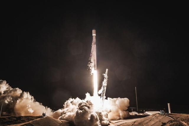 Elon Musk shows off SpaceX's 60 internet-beaming satellites packed together for launch