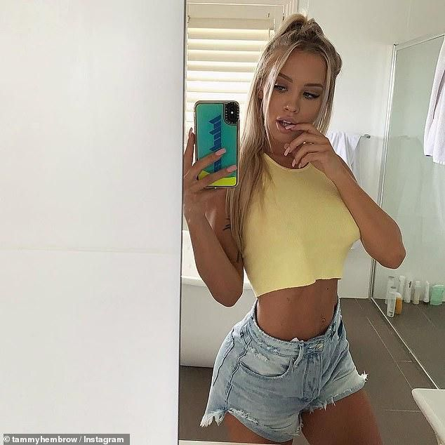 Nipping Out! Tammy Hembrow Puts On A Sexy Display As She Goes Braless In A Yellow Crop Top And Tiny Denim Shorts