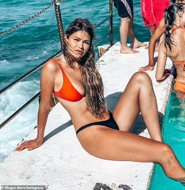 Megan Marx Shows Off Stretch Marks On Her Thighs As She Poses In A Skimpy Bikini