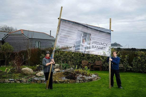 Angry Couple Create Bizarre Banners To Block Neighbours' Views Into Their Garden