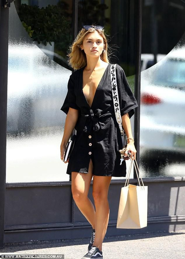 Sarah Ellen Goes Braless As She Wears A Plunging Black Mini-Dress