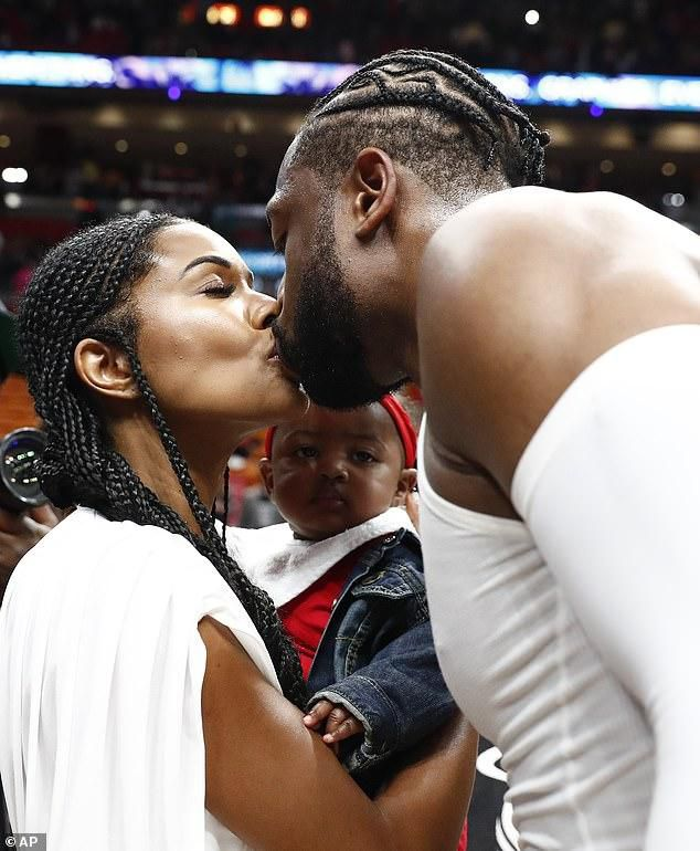 Gabrielle Union Holds On To Baby Daughter Kaavia As She Shares A Passionate Smooch With Dwayne Wade