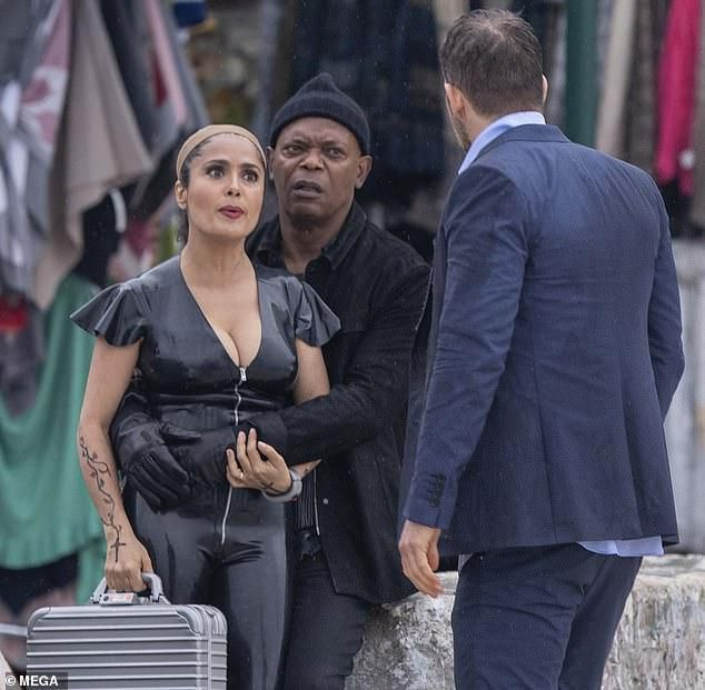 Salma Hayek Shows Off Her Curves In A PVC Pantsuit As Samuel L. Jackson Wraps His Arms Around Her