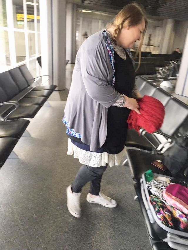 Woman Wears 9 lbs. Of Clothing On Plane To Avoid $85 Overweight Baggage Fee