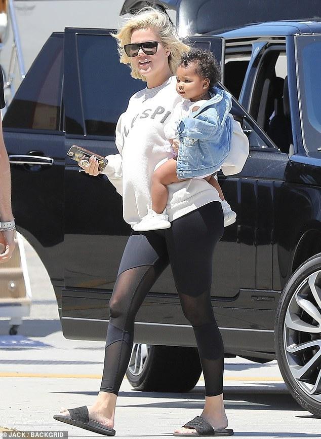 Khloe Kardashian Models Kanye West's Holy Spirit Sweatshirt With Baby True In Her Arms