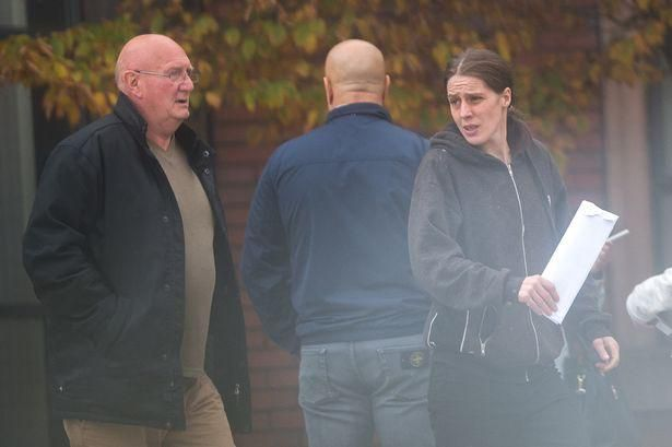 Woman, 27, and ex policeman, 62, 'performed sex act in car outside primary school'