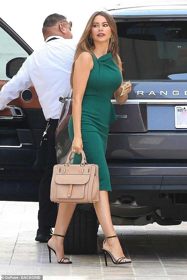 Sofia Vergara flaunts her hourglass curves in a figure-hugging emerald green dress and black heels in Beverly Hills