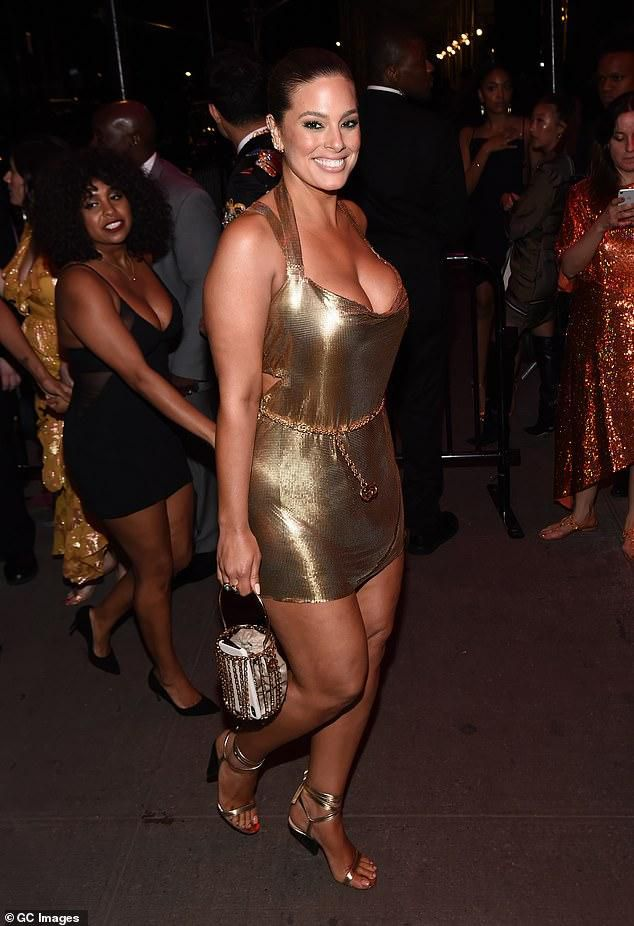 Ashley Graham turns heads in a low-cut gold minidress as she leaves The Standard after-party following the Met Gala 2019