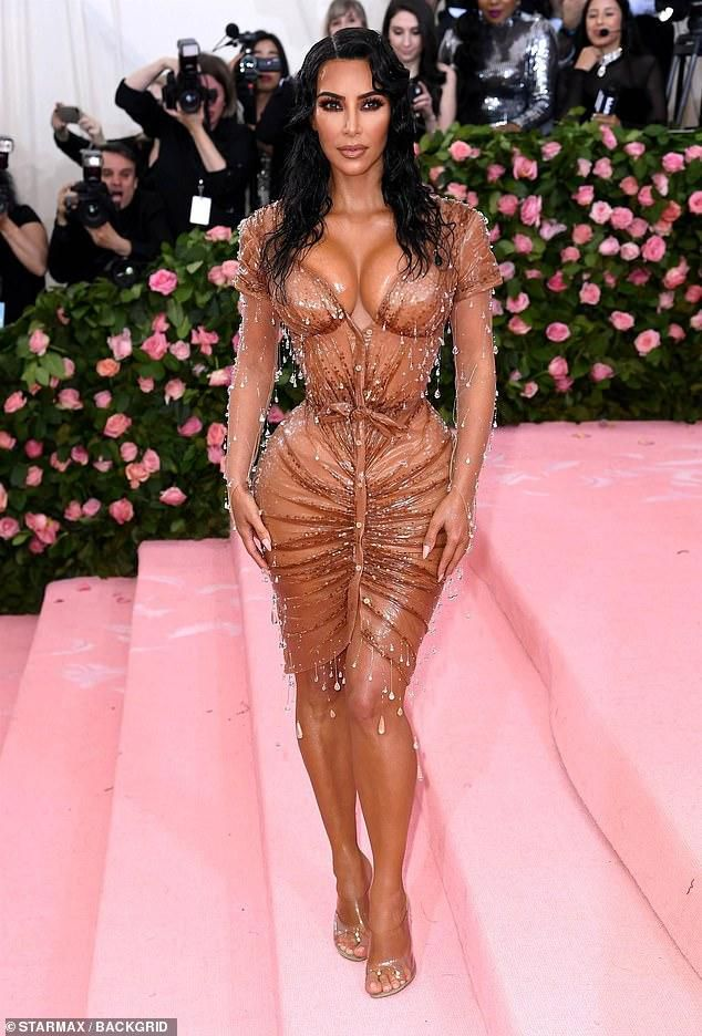 Kim Kardashian's personal trainer SLAMS trolls who claim her body is 'fake'
