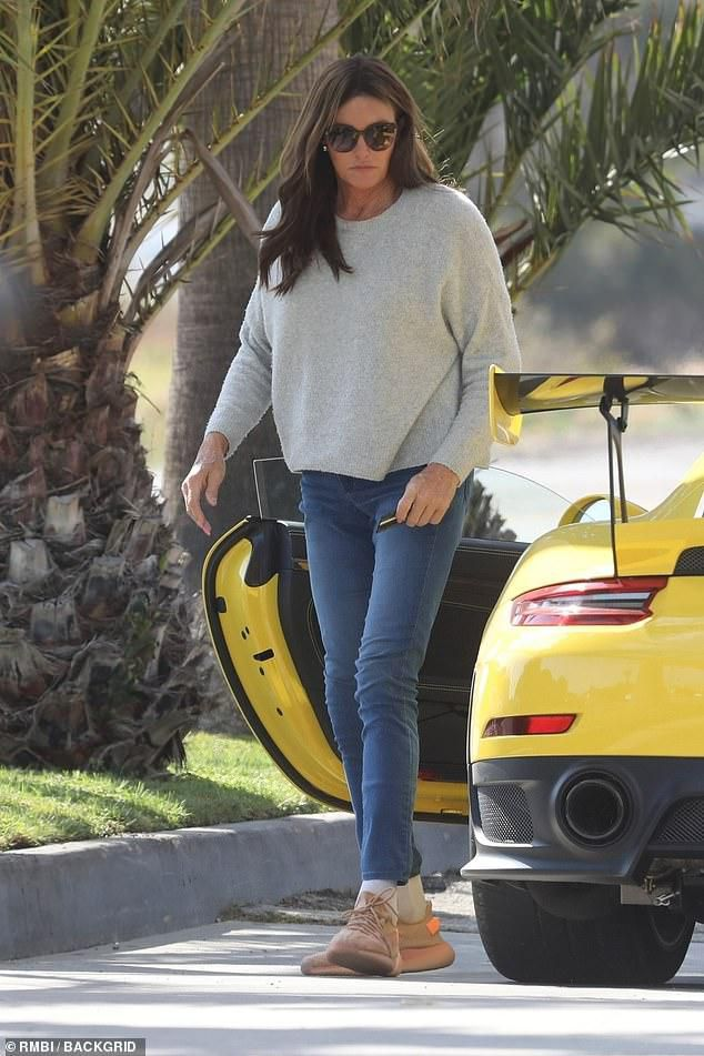 Caityn Jenner slips into jeans and a sweater as the 69-year-old takes her yellow Porsche for a spin