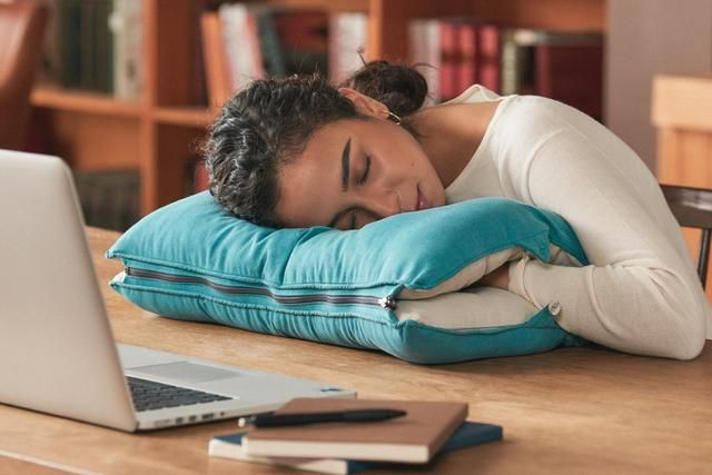 A 2-in-1 pillow that lets you sleep on your bed or at your desk!