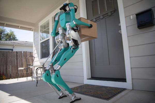 In Ford's future, two-legged robots and self-driving cars could team up on deliveries