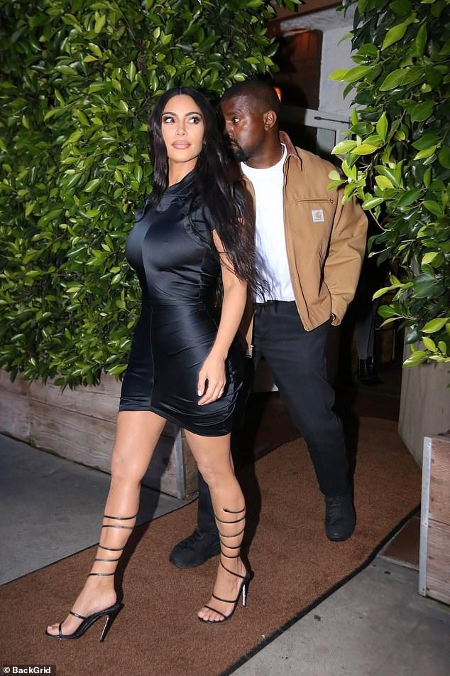 Kim Kardashian flaunts tiny waist in tight mini on date night with Kanye West after welcoming Psalm