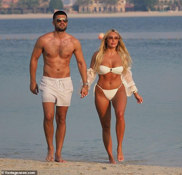 TOWIE's Amber Turner packs on the PDA with her on-off beau Dan Edgar during Dubai getaway
