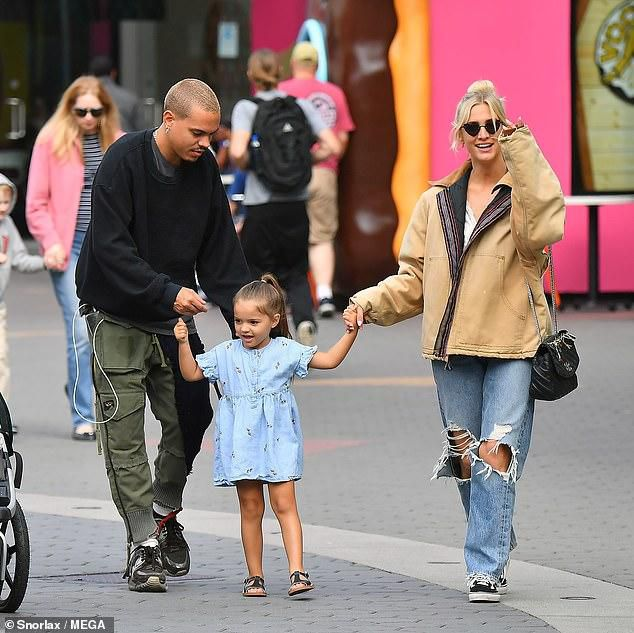 Ashlee Simpson rocks distressed jeans for family fun with Evan Ross and their kids in LA