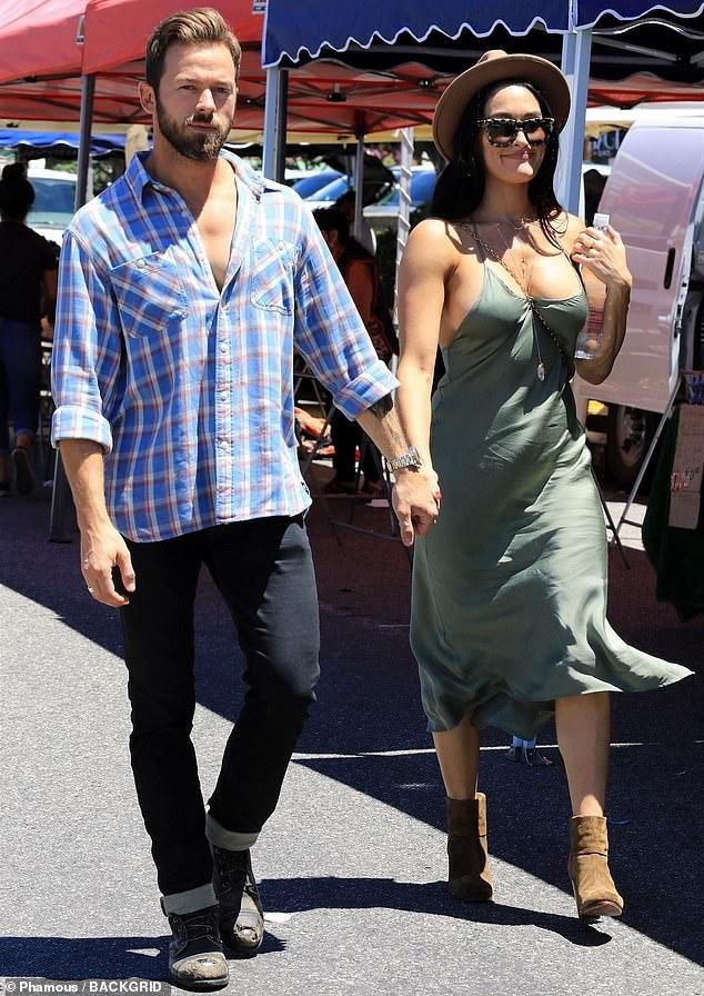 Nikki Bella styles up in a green dress as she and Artem Chigvintsev visit the Farmer's Market in LA