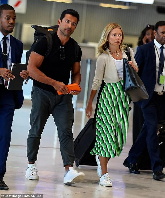 Kelly Ripa and husband Mark Consuelos head home after European vacation where she blasted commenter who trolled her husband