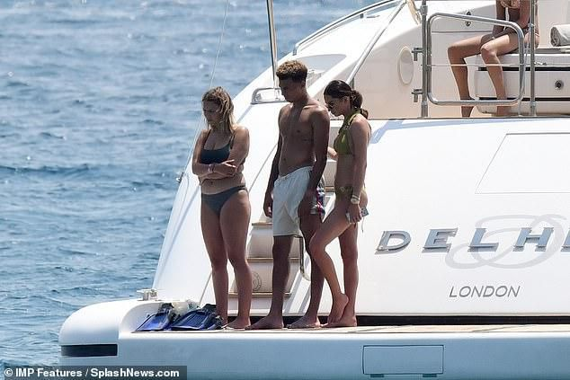 Dele Alli's gorgeous girlfriend Ruby Mae flaunts her phenomenal physique in an olive bikini as she enjoys yacht trip in St. Tropez with footballer