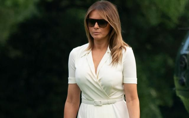 Melania Trump Returns to D.C. in a Chic White Dress and Soaring Nude Leather Louboutins