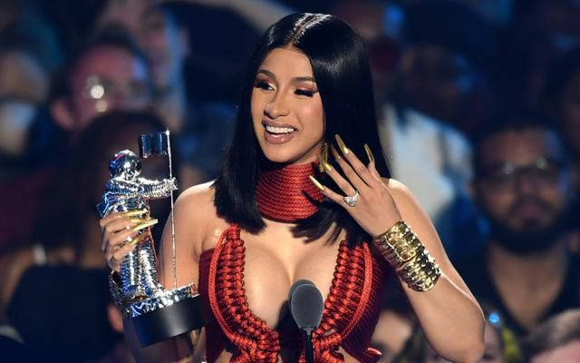Cardi B Accepts Her MTV VMA in Caged Spike Heels and an Unexpected Red Dress