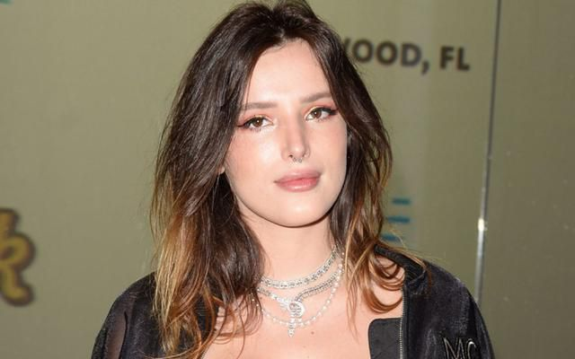 Bella Thorne Gets Into 'Infamous' Character in Denim Cutoffs + Classic Converse