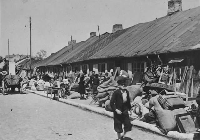 A German Soldier's Photographs of Jews Forced Into A Polish Ghetto
