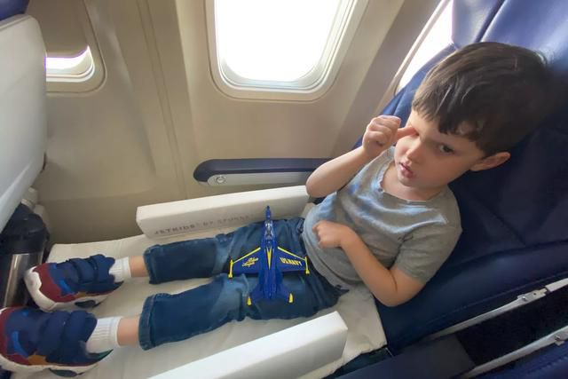 These carry-on bags (almost) turned my twins' airplane seats into beds