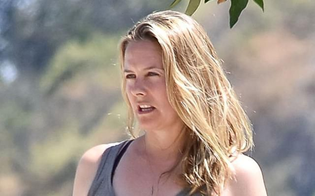 Alicia Silverstone Takes a Hike in the Comfiest Joggers & Bold Adidas Sneakers