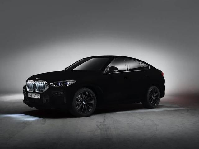 Just what we needed dept: A BMW with paint so black, it's almost invisible