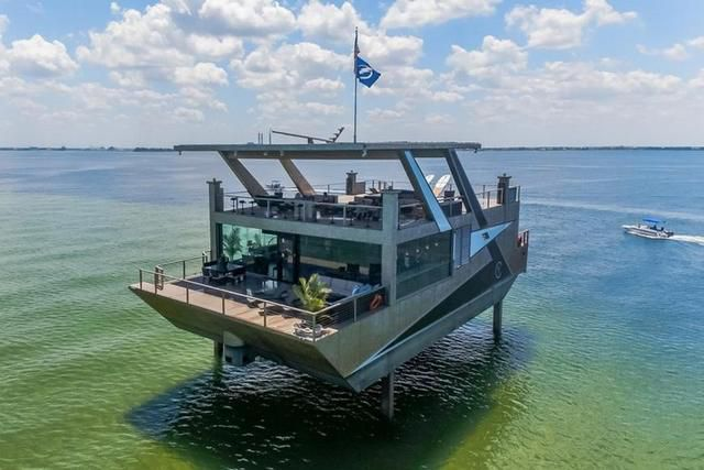 This unique yacht is a floating mansion that can be suspended in the air with its hydraulic legs