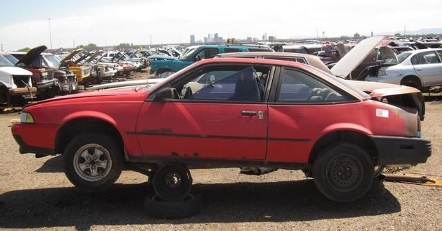 15 Photos Of '90s Cars In The Junkyard... Where They Belong