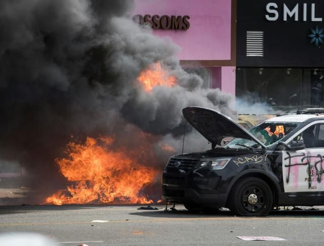 Troops, police clamp down in US cities as unrest over racism flares